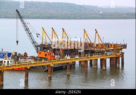 Piling work for new bridge across Zuari River in progress in Goa, India. Aerial view - Stock Photo