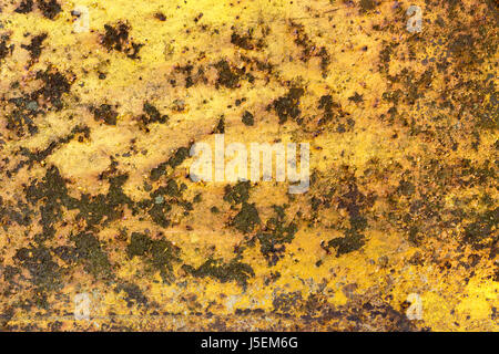 Rusty iron metal surface with yellow paint. Texture and background - Stock Photo