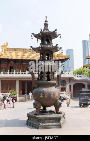 Offering bucket at Jing'An Buddhist temple in Shanghai, China - Stock Photo