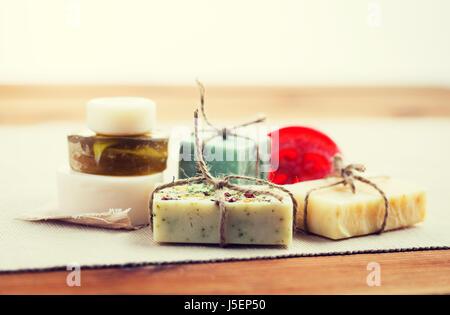 close up of handmade soap bars on wood - Stock Photo