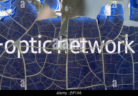 Graphics showing signs of deterioration on the side of a BT public telephone box. - Stock Photo