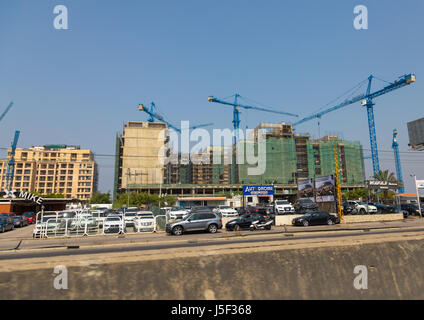 Cars shop in front of buildings under construction, Beirut Governorate, Beirut, Lebanon - Stock Photo