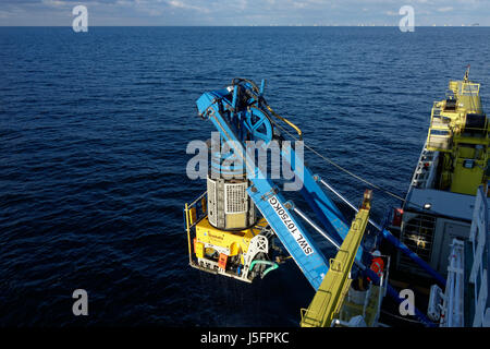 A Remotely Operated Vehicle (ROV) is deployed from a vessel in the Baltic Sea during the construction of the Arkona - Stock Photo