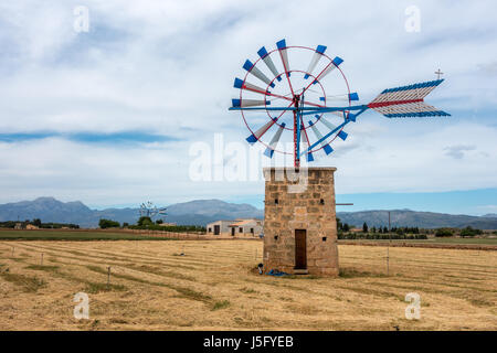 Old windmill used for farming in north Mallorca, Majorca, Balearic Islands, Spain - Stock Photo