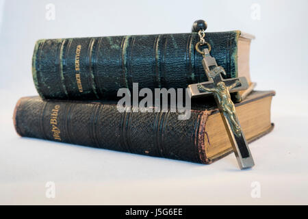 Rosary , Holy Bible and Book of Common Prayer - Stock Photo