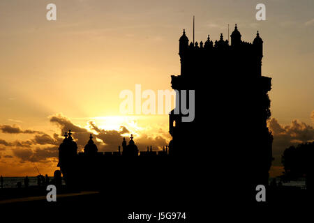 tower shine shines bright lucent light serene luminous historical city town - Stock Photo