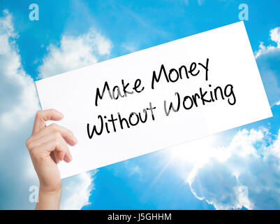Make Money Without Working Sign on white paper. Man Hand Holding Paper with text. Isolated on sky background.   - Stock Photo