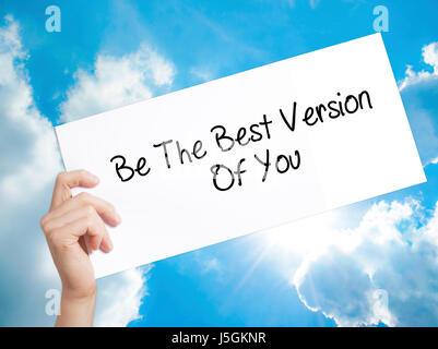 Be The Best Version Of You Sign on white paper. Man Hand Holding Paper with text. Isolated on sky background.   - Stock Photo