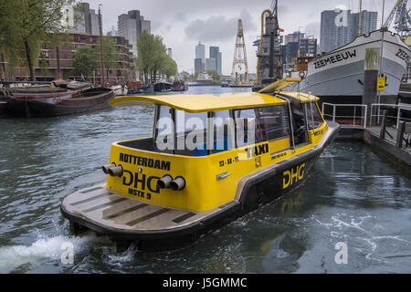 Rotterdam water taxi arriving at Maritime Museum Harbour, Leuvehaven, Rotterdam, The Netherlands. - Stock Photo