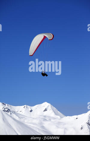Paraglider in snowy winter mountains. Caucasus Mountains. Georgia, ski resort Gudauri. - Stock Photo