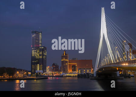 Erasmusbrug (Erasmus Bridge) and city skyline at twilight, Rotterdam, The Netherlands. - Stock Photo