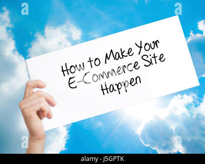 How to Make Your E-Commerce Site Happen Sign on white paper. Man Hand Holding Paper with text. Isolated on sky background. - Stock Photo