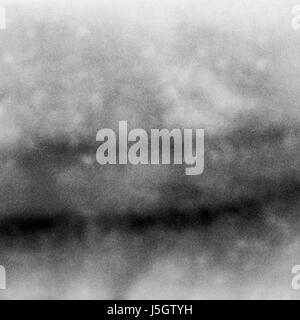 Abstract black and white grained film strip - Stock Photo