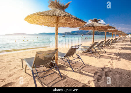 Beach chairs with a white sand on San Ciprianu beach near Porto-Vecchio in Corsica, France, Europe - Stock Photo
