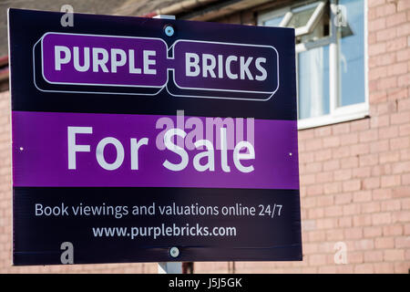A Purple Bricks for sale sign. Shropshire, West Midlands, UK. - Stock Photo