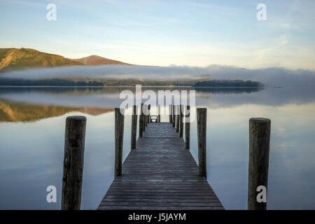 Reflections of Ashness Gate or Barrow Bay old jetty in Derwentwater, Lake District National Park, Cumbria, England, UK