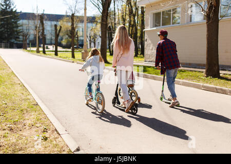 Couple with children on bicycles - Stock Photo