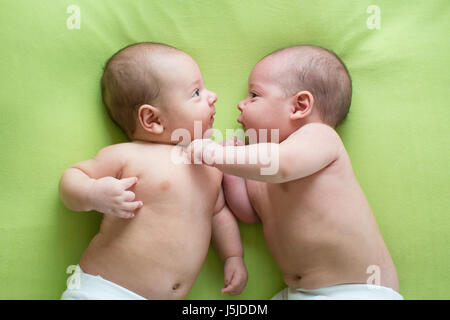 Two baby boys twin brothers - Stock Photo