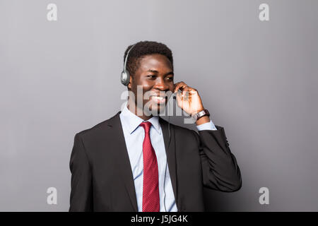 Closeup portrait of a young male customer service representative or call centre worker or operator, support staff - Stock Photo
