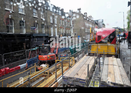 Construction lorry and double-decker bus in traffic congestion going to city centre on Essex Road near Islington - Stock Photo