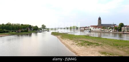 Panorama of IJssel River at Deventer, Netherlands. Skyline with Great or  St. Lebuinus Church River forelands / - Stock Photo