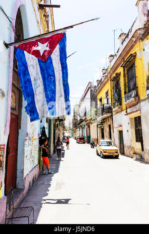 Cuban flag outside Cuban home Havana street Havana streets Cuba street typical Cuban street road roads Cuba - Stock Photo
