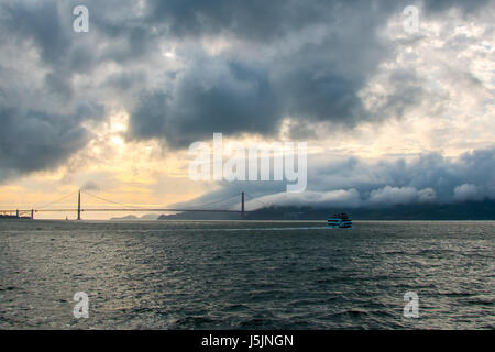 View of Passanger Boat Traveling towards Golden Gate Bridge Mountain - Stock Photo