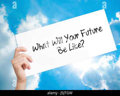 What Will Your Future Be Like? Sign on white paper. Man Hand Holding Paper with text. Isolated on sky background. - Stock Photo