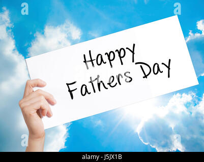 Happy Fathers Day Sign on white paper. Man Hand Holding Paper with text. Isolated on sky background.  Business concept. - Stock Photo