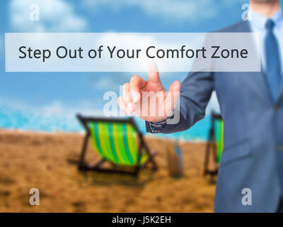 Step Out of Your Comfort Zone - Businessman hand pressing button on touch screen interface. Business, technology, internet concept. Stock Photo
