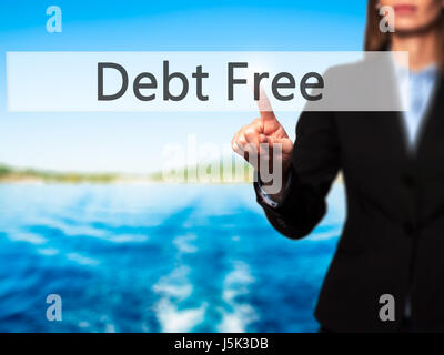 Debt Free - Business woman point finger on push touch screen and pressing digital virtual button. Business, technology, - Stock Photo
