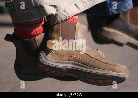 wait waiting boot blue fashionable modern modernity brown brownish brunette - Stock Photo