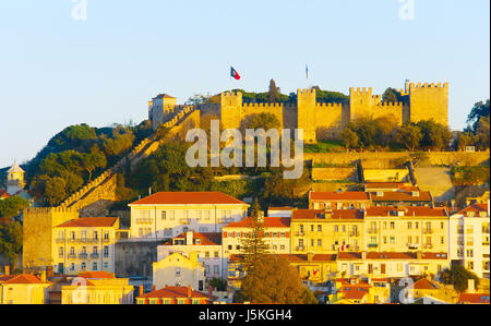 Lisbon Castle on a top of a hill at sunset. Lisbon, Portugal - Stock Photo