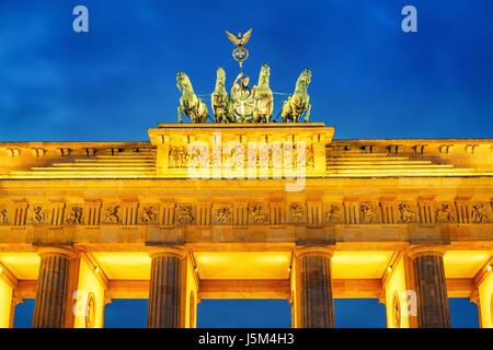 Brandenburg gate at dusk, Berlin - Stock Photo
