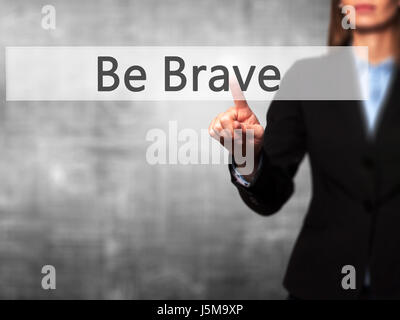 Be Brave -  Female touching virtual button. Business, internet concept. Stock Photo - Stock Photo