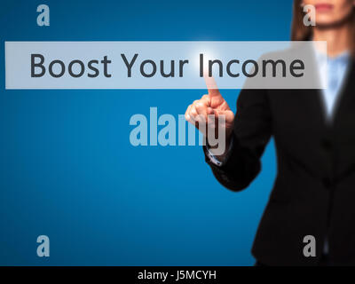 Boost Your Income - Young girl working with virtual screen an touching button. Technology, internet concept. Stock - Stock Photo
