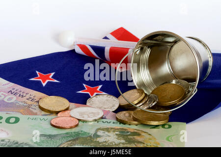 New Zealand money and a bucket. - Stock Photo