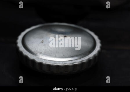 silver closed metal seal shutter lid fasteners tankdeckel tankverschluss - Stock Photo