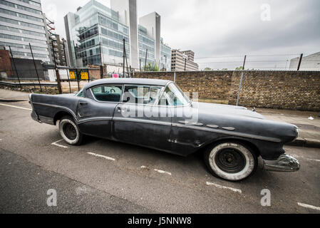 Aging 1950s (1956 ?) Buick Super Riviera in a London side street. With whitewall tyres / tires. Decay. Space for - Stock Photo