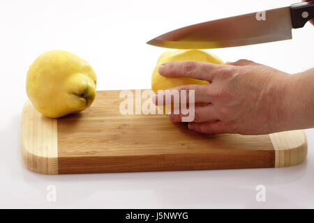 hand pome fruit quinces jam cut jelly season medicinal plant liqueur carving - Stock Photo