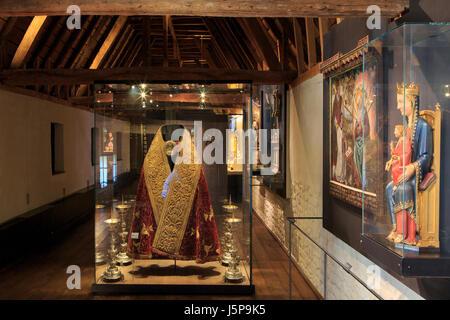 A Roman Catholic vestment and various relics on display at the Teseum in Tongeren, Belgium - Stock Photo