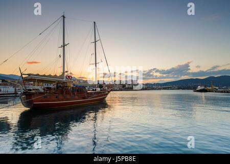 Evening view of Agios Nikolaos and its harbor, Crete, Greece. - Stock Photo