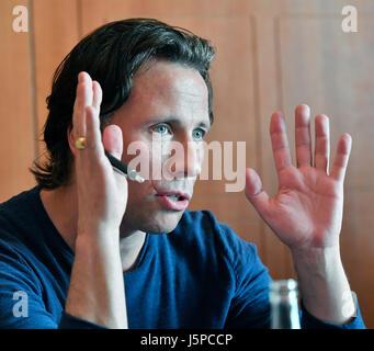 Estonian conductor Kristjan Jarvi speaks during press conference within Prague Spring music festival in Prague, - Stock Photo