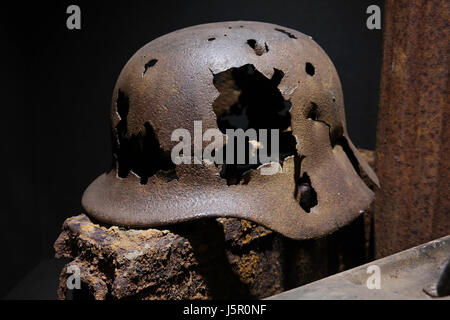 A rusty German World War Two military helmet - Stock Photo