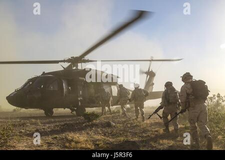 U.S. soldiers load into a U.S. Army UH-60 Black Hawk utility helicopter during a training exercise at the National - Stock Photo