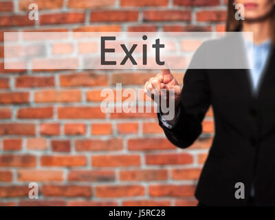 Exit - Businesswoman hand pressing button on touch screen interface. Business, technology, internet concept. Stock - Stock Photo
