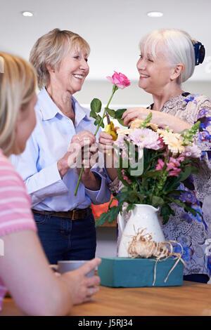 Women Meeting At Flower Arranging Class - Stock Photo