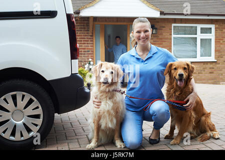 Portrait Of Woman Running Dog Walking Service - Stock Photo