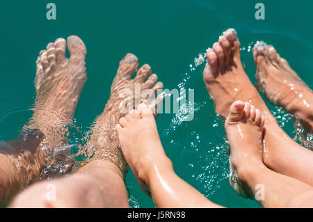 Happy family. Bare feets in the water of the sea boy, mother, father. Positive human emotions, feelings, joy. Funny - Stock Photo