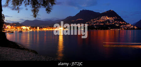 shine shines bright lucent light serene luminous night nighttime evening - Stock Photo